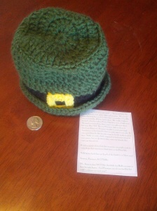 Finnegan's hat and this year's note.