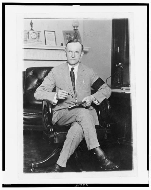President Calvin Coolidge wearing an armband in mourning for President Harding.  Photo found at americanhistory.unomaha.edu