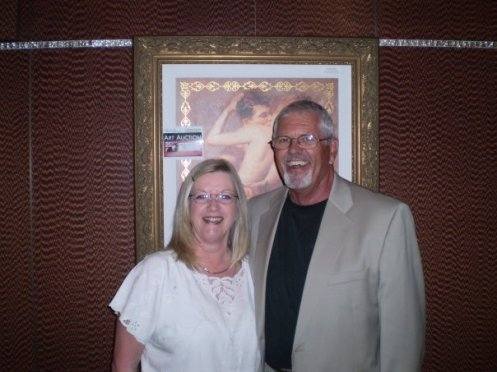 My Mom & Dad.  And no! They do not normally pose in front of racy art auction paintings.