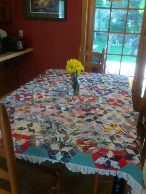This tablecloth quilt was hand stitched by my Nanny.